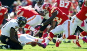 Kansas City Chiefs running back Cyrus Gray fumbles the ball in front of Baltimore Ravens strong safety Bernard Pollard in the first quarter that...