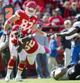 Kansas City Chiefs running back Cyrus Gray leaps for a first down in the fourth quarter against during Sunday's football game against the Baltimore...