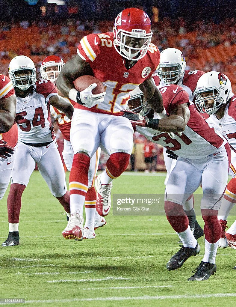 Kansas City Chiefs running back Cyrus Gray (42) leaps into the end zone for a touchdown in the fourth quarter against the Arizona Cardinals on August 10, 2012, at Arrowhead Stadium in Kansas City, Missouri. The Chiefs defeated the Cardinals, 27-17.