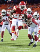 Kansas City Chiefs running back Cyrus Gray leaps into the end zone for a touchdown in the fourth quarter against the Arizona Cardinals on August 10...