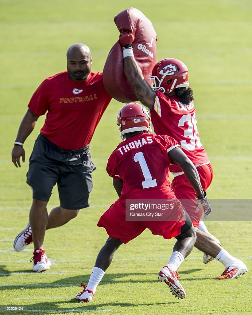 Kansas City Chiefs running back De'Anthony Thomas (1) eludes a block by fullback Jordan Campbell (38) during the team's training camp practice at Missouri Western State University in St. Joseph, Mo., on Tuesday, July 22, 2014.