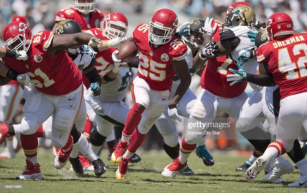 Kansas City Chiefs running back Jamaal Charles (25) finds a hole in the offensive line for an 18-yard gain against the Jacksonville Jaguars at Everbank Field in Jacksonville, Florida, on Sunday, September 8, 2013. The Chiefs won, 28-2.