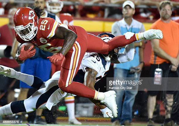 Kansas City Chiefs running back Jamaal Charles top is cut down by Denver Broncos cornerback Chris Harris in the third quarter on Thursday Sept 17 at...