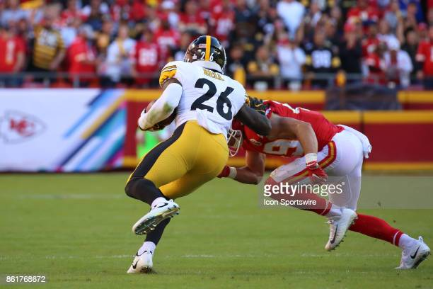 Kansas City Chiefs strong safety Daniel Sorensen tries to bring down Pittsburgh Steelers running back Le'Veon Bell in the second quarter of a week 6...