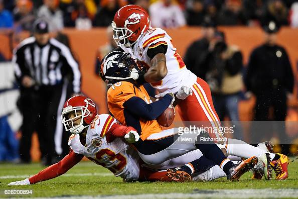 Kansas City Chiefs strong safety Eric Berry goes high on Denver Broncos wide receiver Emmanuel Sanders as cornerback Phillip Gaines assists on the...