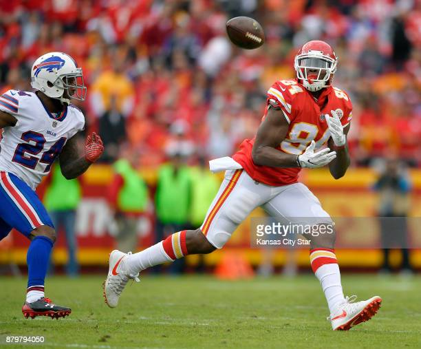Kansas City Chiefs tight end Demetrius Harris catches a first down pass in front of Buffalo Bills defensive back Leonard Johnson in the second...