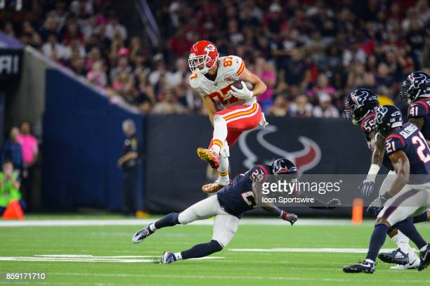 Kansas City Chiefs tight end Travis Kelce hurdles Houston Texans free safety Andre Hal during the NFL game between the Kansas City Chief and the...