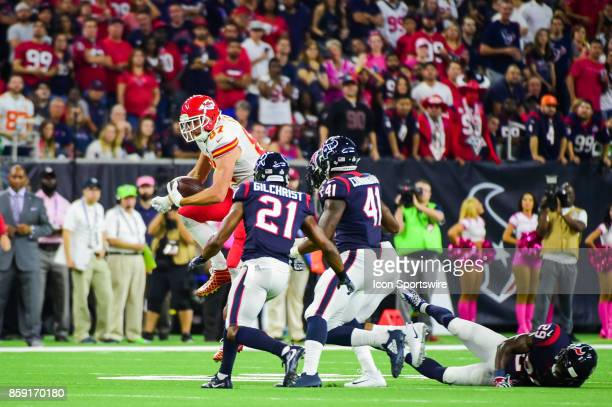 Kansas City Chiefs tight end Travis Kelce hurdles Houston Texans safety Andre Hal as Houston Texans safety Marcus Gilchrist and Houston Texans...