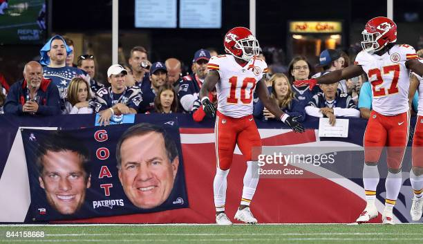 Kansas City Chiefs' Tyreek Hill celebrates his third quarter 75 yard touchdown reception with teammate Kareem Hunt in front of some Patriots fans The...