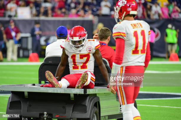 Kansas City Chiefs wide receiver Chris Conley is carted off the field with a knee injury as Kansas City Chiefs quarterback Alex Smith looks on during...