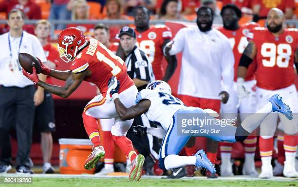 Kansas City Chiefs wide receiver Demarcus Robinson catches a 50yard pass in front of Tennessee Titans cornerback Brice McCain at Arrowhead Stadium in...