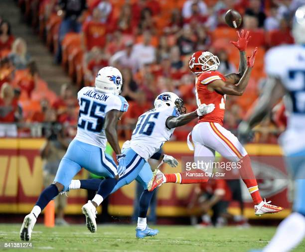 Kansas City Chiefs wide receiver Demarcus Robinson right catches a long pass reception for a first down from quarterback Patrick Mahomes in the first...