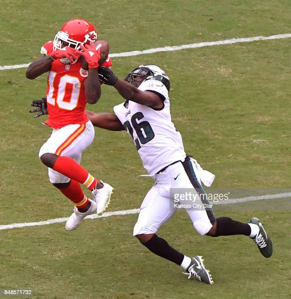 Kansas City Chiefs wide receiver Tyreek Hill catches a 14yard pass in front of Philadelphia Eagles defensive back Jaylen Watkins in the first quarter...