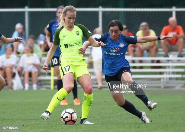 Kansas City defender Christina Gibbons tries to take the ball from Seattle Reign FC forward Beverly Yanez in the first half of an NWSL match between...