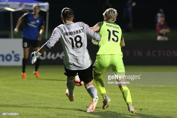 Kansas City goalkeeper Nicole Barnhart just beats Seattle Reign FC forward Megan Rapinoe to the ball in the second half of an NWSL match between the...