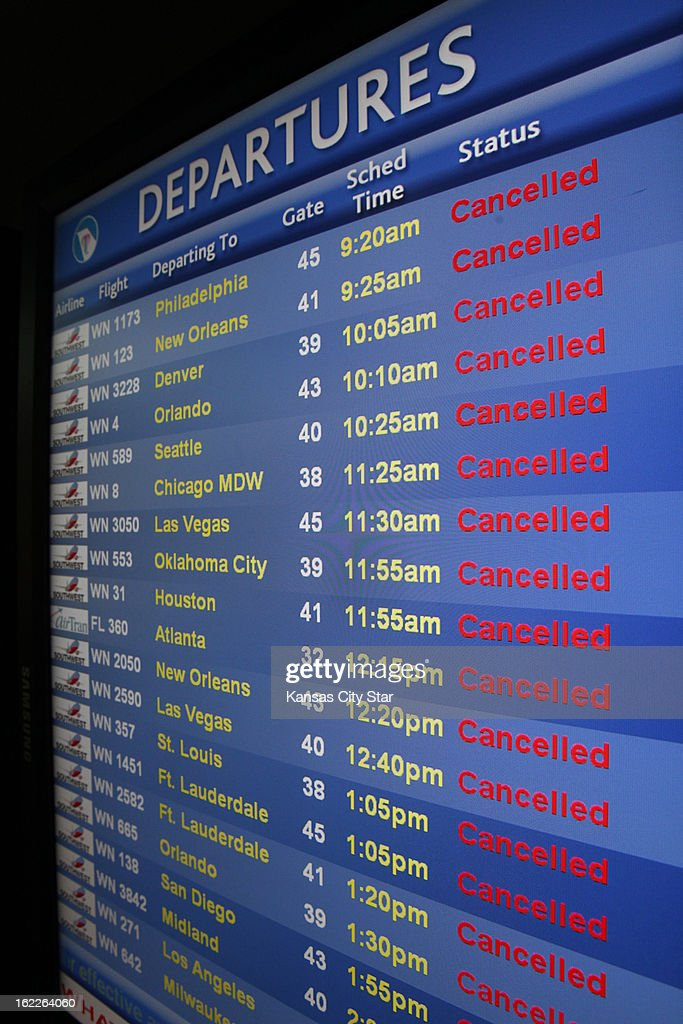 Kansas City International Airport flight status boards were loaded with cancelled flights due to Thursday's heavy snow, February 21, 2013.