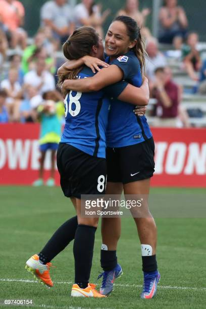 Kansas City midfielder Alexa Newfield celebrates her goal with midfielder Lo'eau Labonta in the first half of an NWSL match between the Seattle Reign...