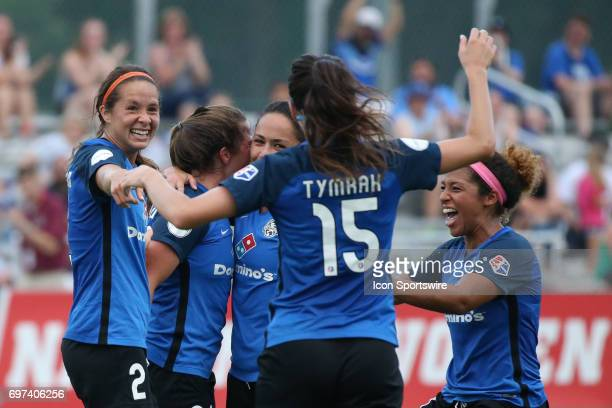Kansas City midfielder Alexa Newfield teammates celebrate her goal in the first half of an NWSL match between the Seattle Reign FC and FC Kansas City...