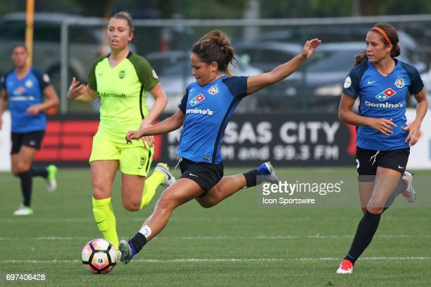 Kansas City midfielder Lo'eau Labonta winds up to shoot in the first half of an NWSL match between the Seattle Reign FC and FC Kansas City on June 17...