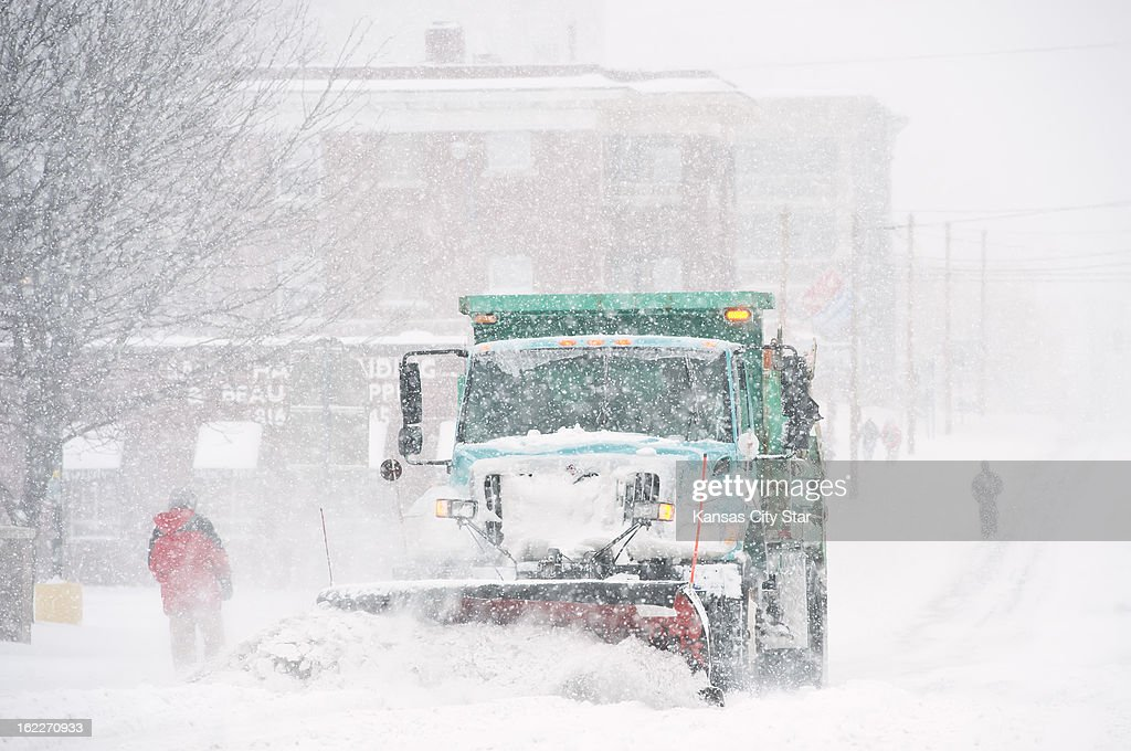A Kansas City, Missouri city snow plow cleared one lane at 39th Street and Broadway Boulevard during heavy snowfall that blanketed the metro area, Thursday, February 21, 2013.