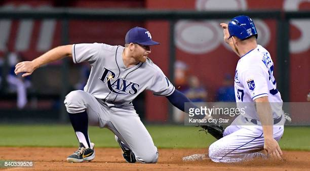 Kansas City Royals' Brandon Moss is tagged out by Tampa Bay Rays second baseman Brad Miller trying to steal second to end the third inning Aug 28...