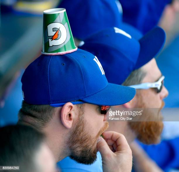 Kansas City Royals' Brandon Moss sits in the dugout with a cup stuck to his hat during a baseball game against the Cleveland Indians on Sunday Aug 20...
