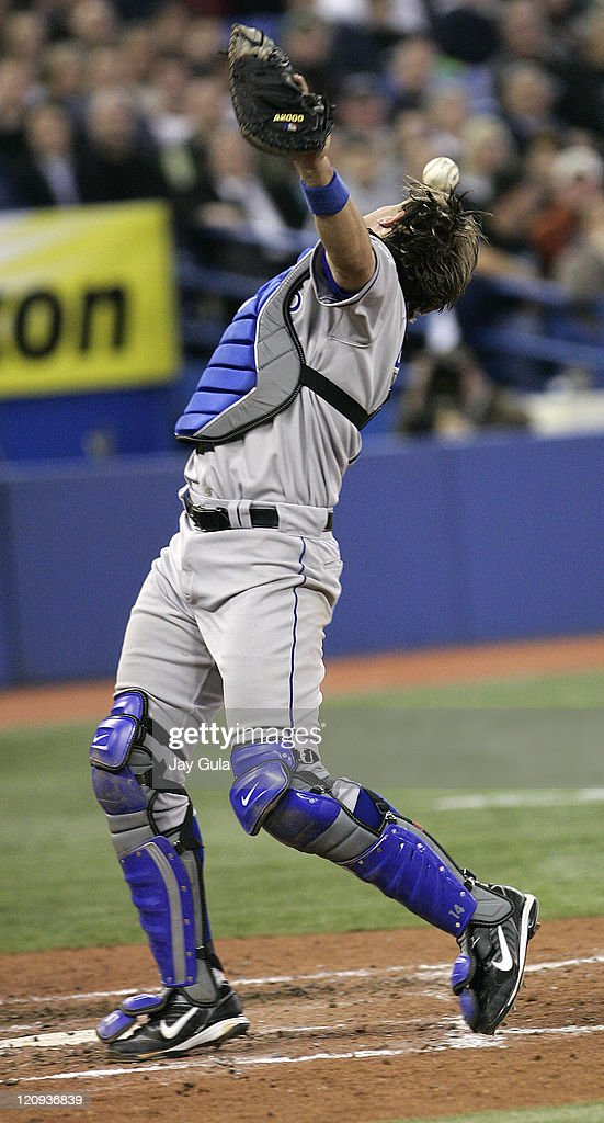 Kansas City Royals C John Buck dropped this foul pop off the bat of Vernon Wells in MLB action vs the Toronto Blue Jays at Rogers Centre in Toronto...