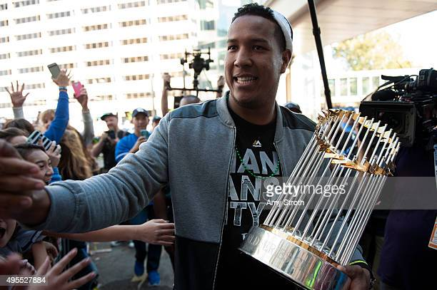 Kansas City Royals catcher and World Series MVP Salvador Perez carries the Commissioner's Trophy during the Kansas City Royals World Series parade...