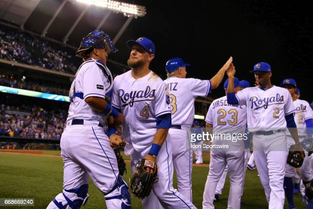 Kansas City Royals catcher Salvador Perez and left fielder Alex Gordon chest bump in celebration after an MLB game between the Los Angeles Angels of...