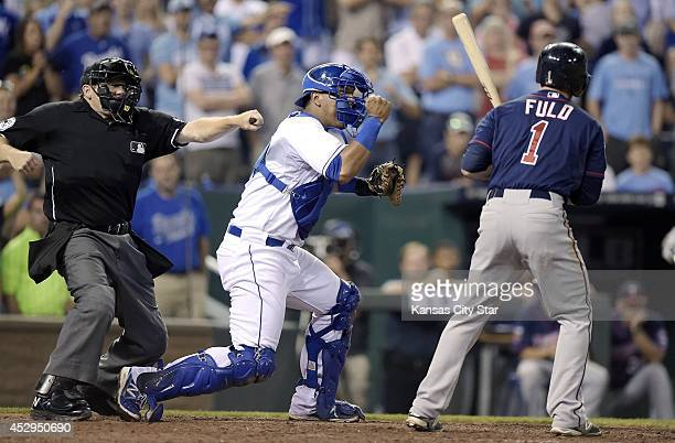 Kansas City Royals catcher Salvador Perez celebrates after the Minnesota Twins' Sam Fuld struck out to end the game in the ninth inning on a pitch...