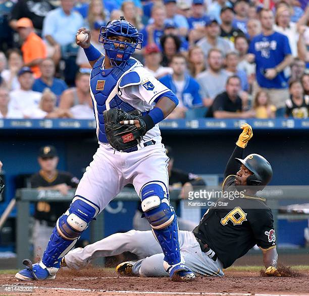 Kansas City Royals catcher Salvador Perez forces out Pittsburgh Pirates' Andrew McCutchen before throwing to first on a bases loaded fielders choice...