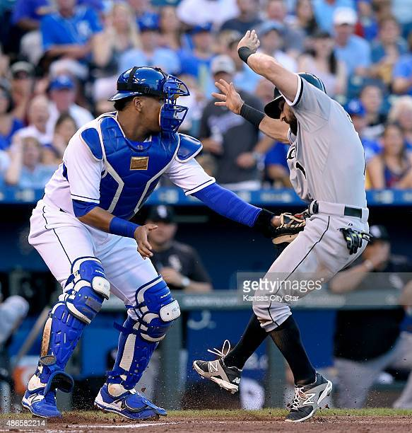 Kansas City Royals catcher Salvador Perez left tags out the Chicago White Sox's Adam Eaton at the plate on a fielder's choice hit into by Melky...