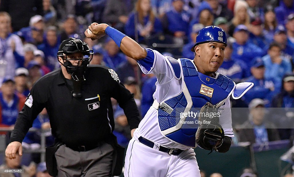 Kansas City Royals catcher Salvador Perez throws to first to retire the New York Mets' Daniel Murphy on a third-strike wild pitch in the 12th inning in Game 1 of the World Series on Tuesday, Oct. 27, 2015, at Kauffman Stadium in Kansas City, Mo.