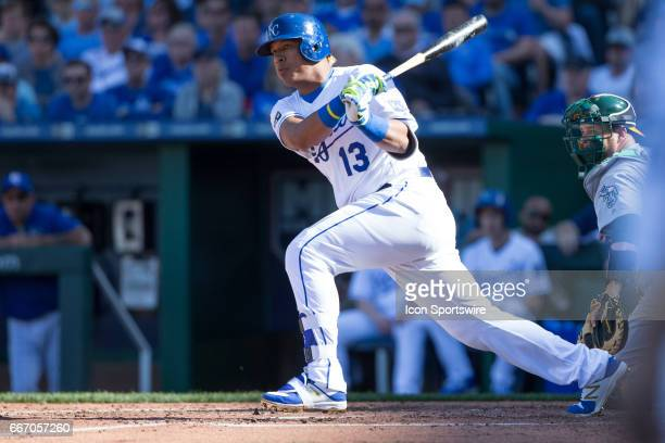 Kansas City Royals catcher Salvador Perez watches the ball after a hit during the Kansas City home opening game between the Oakland Athletics and the...