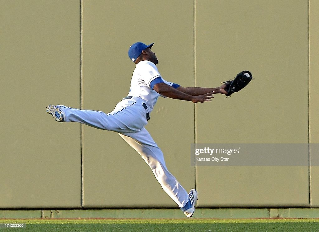 Kansas City Royals center fielder Lorenzo Cain (6) makes a leaping catch on a ball hit by the Baltimore Orioles' Adam Jones for the third out of the second inning at Kauffman Stadium in Kansas City, Missouri, Monday, July 22, 2013.