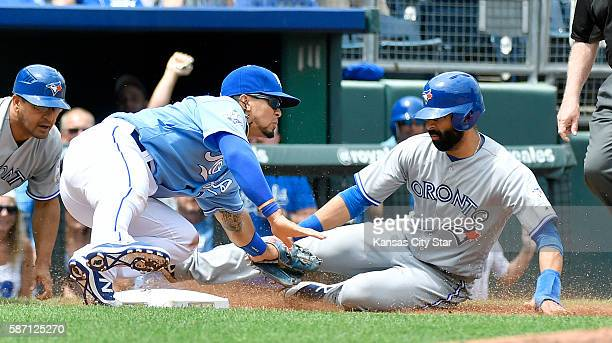 Kansas City Royals' Cheslor Cuthbert tags out Toronto Blue Jays' Jose Bautista as he tries to advance to third on a Josh Donaldson single and throw...