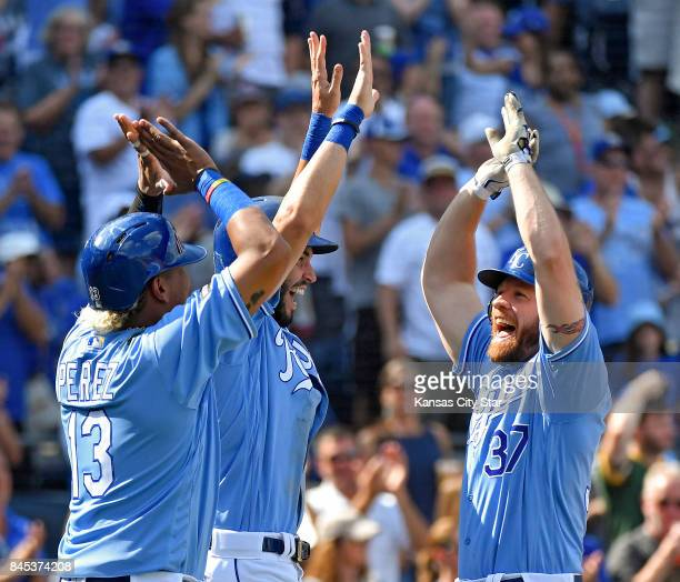 Kansas City Royals designated hitter Brandon Moss celebrates his threerun home run in the seventh inning with Salvador Perez and Eric Hosmer against...