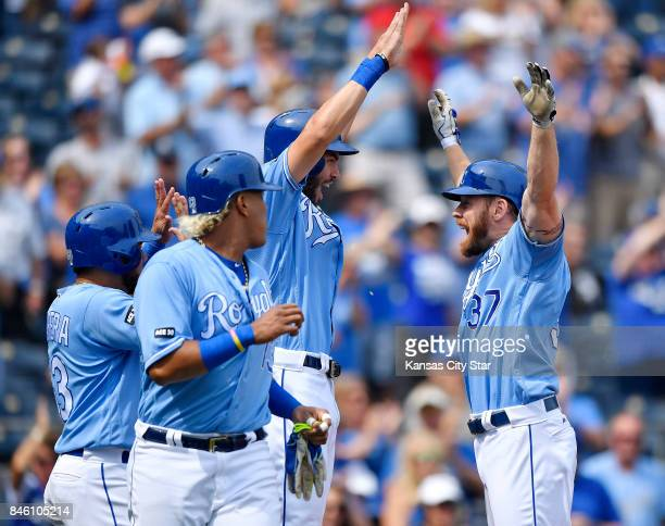 Kansas City Royals designated hitter Brandon Moss celebrates his first inning grand slam with Eric Hosmer Melky Cabrera and Salvador Perez against...