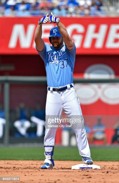 Kansas City Royals designated hitter Brandon Moss celebrates his RBI double that scored Eric Hosmer in the second inning against the Minnesota Twins...