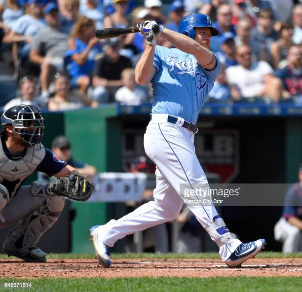 Kansas City Royals designated hitter Brandon Moss follows through on an RBI double to score Eric Hosmer in the second inning against the Minnesota...