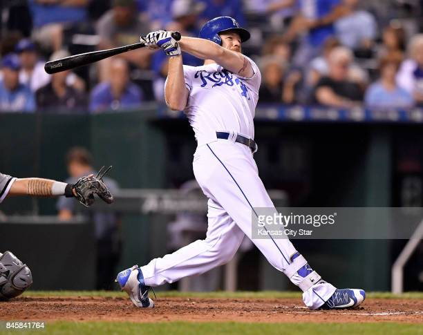 Kansas City Royals designated hitter Brandon Moss follows through on a solo home run in the fifth inning during Monday's baseball game against the...