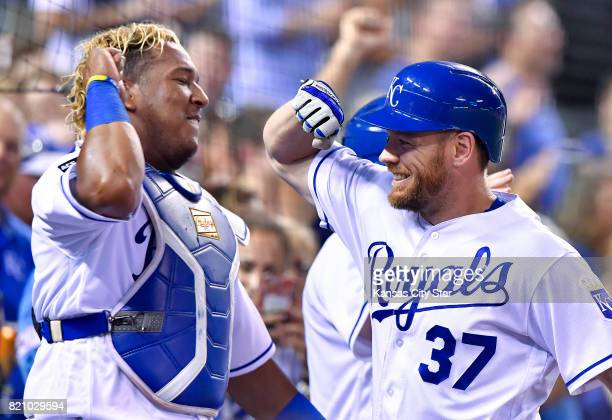 Kansas City Royals designated hitter Brandon Moss is congratulated by Salvador Perez after Moss hit a solo home run in the sixth inning against the...