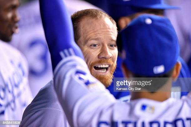 Kansas City Royals designated hitter Brandon Moss is congratulated after hitting a solo home run in the fifth inning during Monday's baseball game...
