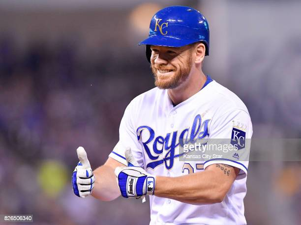Kansas City Royals designated hitter Brandon Moss signals back to the dugout after his RBI single scored Mike Moustakas in the fifth inning against...
