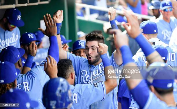 Kansas City Royals' Eric Hosmer celebrates in the dugout after he scored along with Salvador Perez on a threerun home run by Brandon Moss in the...