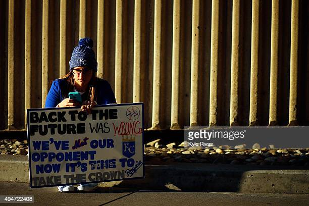 Kansas City Royals fan holds a sign that reads 'Back to the Future was Wrong We've Met Our Opponent Now it't Time to Take the Crown' prior to Game...
