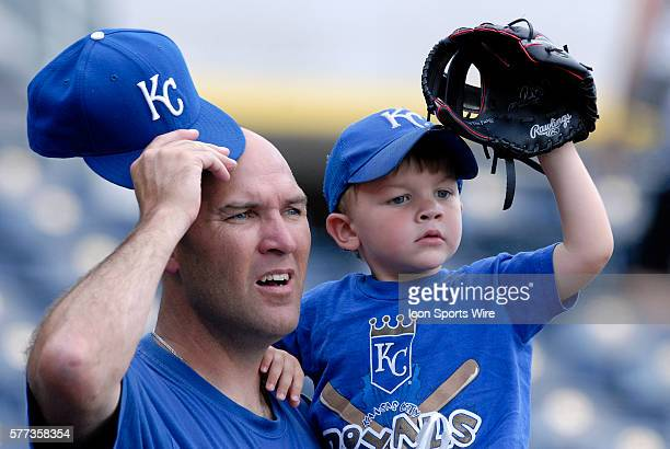 Kansas City Royals fans Joe Witherow and his son Johnny watch the game against the Detroit Tigers at Kauffman Stadium in Kansas City Missouri The...