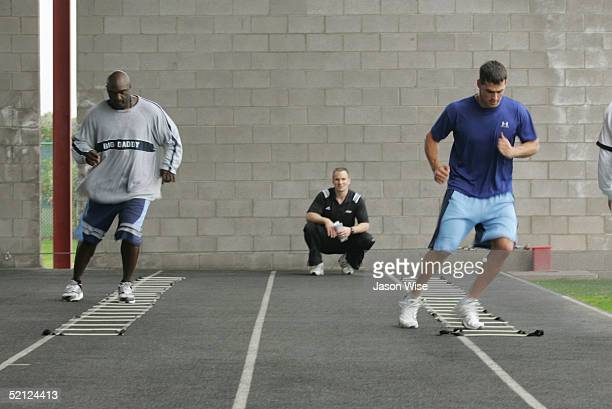 Kansas City Royals first baseman Calvin Pickering and Texas Rangers centerfielder Ricky Asadoorian perform ladder agility drills while Founder and...