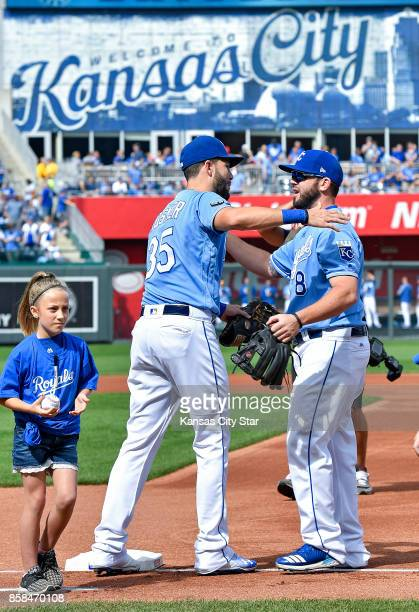 Kansas City Royals first baseman Eric Hosmer and third baseman Mike Moustakas hug after the national anthem before a game against the Arizona...