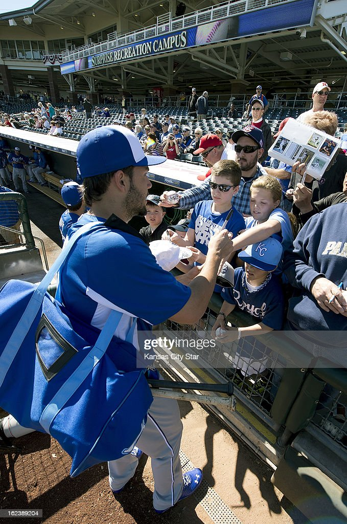 Kansas City Royals first baseman Eric Hosmer (35) stops to sign autographs before the start of a spring training baseball game against the Texas Rangers in Surprise, Arizona, Friday, February 22, 2013. The game ended in a 5-5 tie.